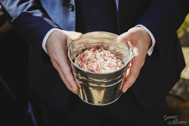 Pink-and-cream-confetti-petals-insilver-buckets-for-guests-to-help-themselves