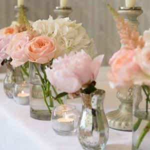 pink-peach-wedding-ceremony-table-flowers-in-glass-vases-and-mercury-silver-vases-hampton-manor