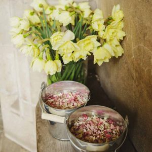 Pink-petal-confetti-at-church-in-silver-buckets-available-from-@theweddingomd