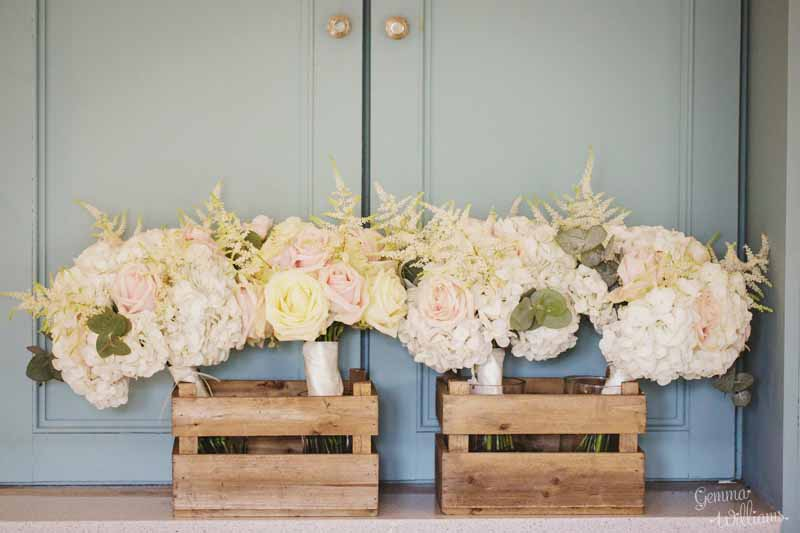 Pretty-bridesmaids-bouquets-delivered-in-wooden-crates.-Hydrangeas-astilbe-avalanche-and-sweet-avalanche-roses