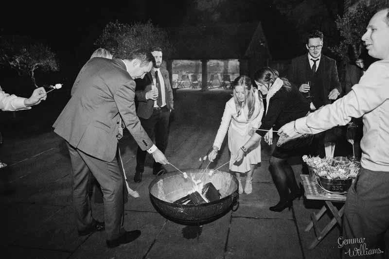Roasting-marshmallows-at-Shustoke-Farm-Barns-wedding