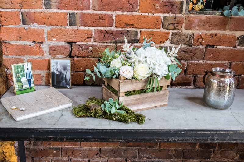 rustic-crate-of-flowers-of-guest-book-table-at-shustoke-farm-barns