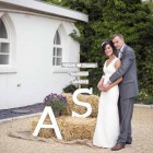 rustic-wedding-details-stack-of-hay-bales-with-bride-and-grooms-initials