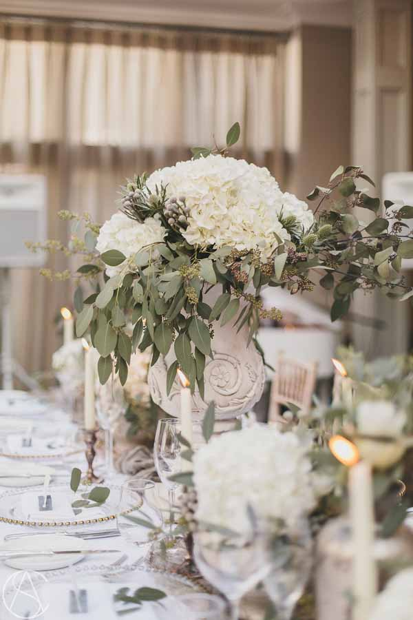 stone-urn-centrepieces-white-hydrangeas-winter-wedding-flowershampton-manor-wedding-florist-passion-for-flowers-20
