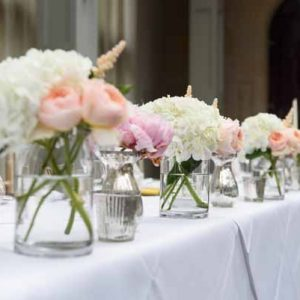 summer-wedding-top-table-flowers-in-glass-vases-pink-and-peach-wedding