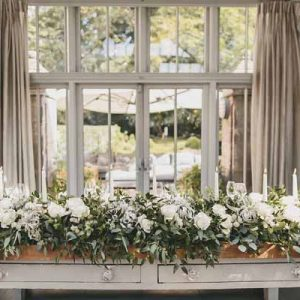 top-table-floral-garlands-with-candle-sticks-wow-factor-hampton-manor-wedding-florist-passion-for-flowers
