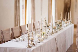top-table-wedidng-decorations-mercury-silver-candle-sticks-crystal-glass-vases-white-roses-by-passion-for-flowers