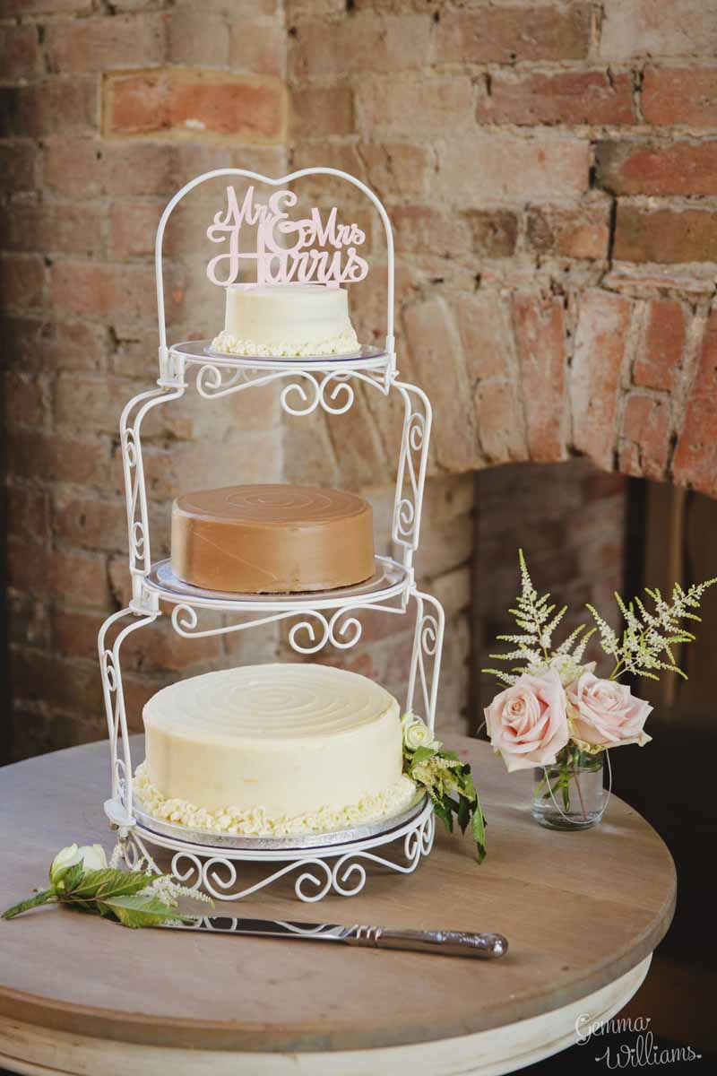 Wedding-cake-at-barn-wedding-with-personalised-cake-topper