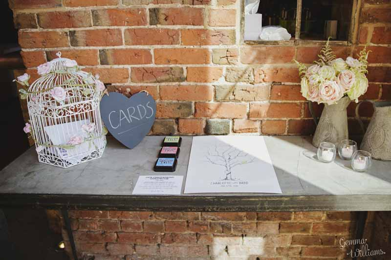 Wedding-cards-table-withfingerprint-guest-book-jugs-of-flowers