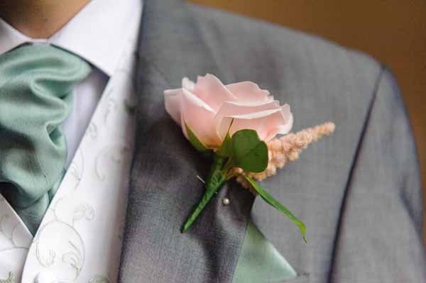 pink-sweet-avalanche-rose-button-holes-grey-suit