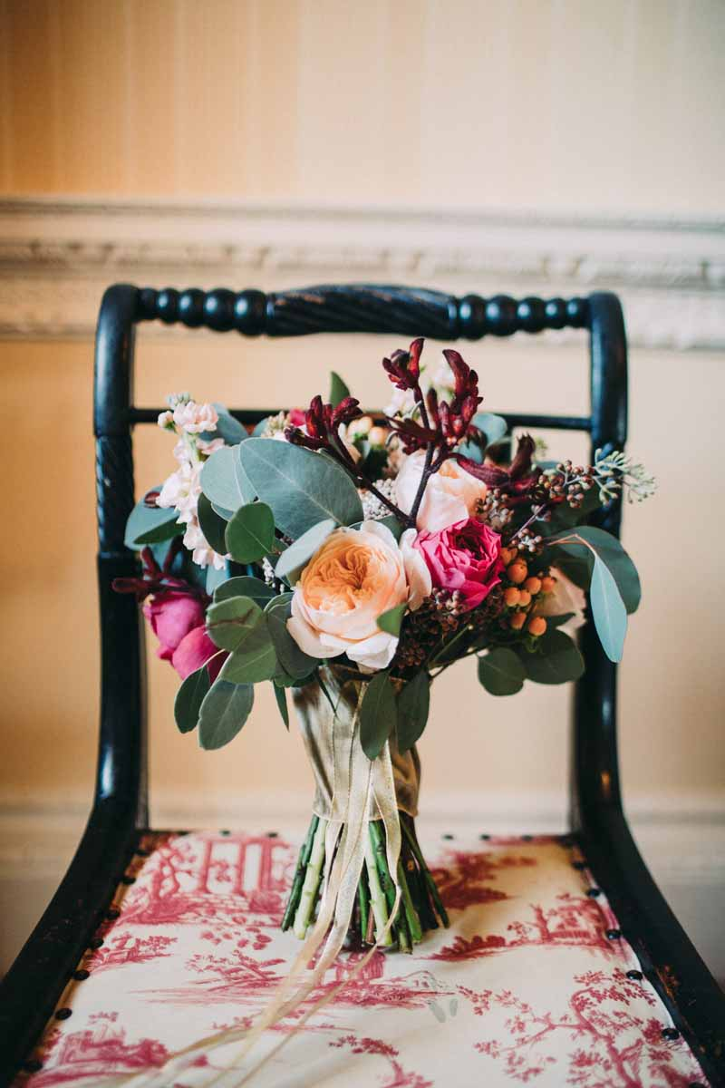 autumn-wedding-bouquet-free-form-deep-red-pink-and-peach-roses-with-foliage-by-passion-for-flowers-david-austin-roses