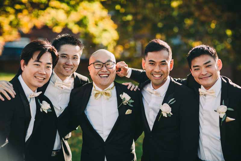 black-grooms-suits-blush-pink-rose-button-holes