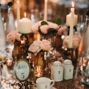 blush-pink-and-gold-wedding-centrepieces-on-glitter-table-cloths-by-kmorganflowers-1