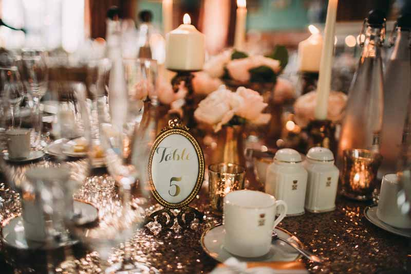 blush-pink-and-gold-wedding-centrepieces-on-glitter-table-cloths-by-kmorganflowers-2