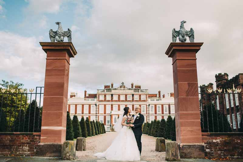 bride-and-groom-portraits-knowsley-hall-deep-pink-burgundy-wedding-bouquet-1