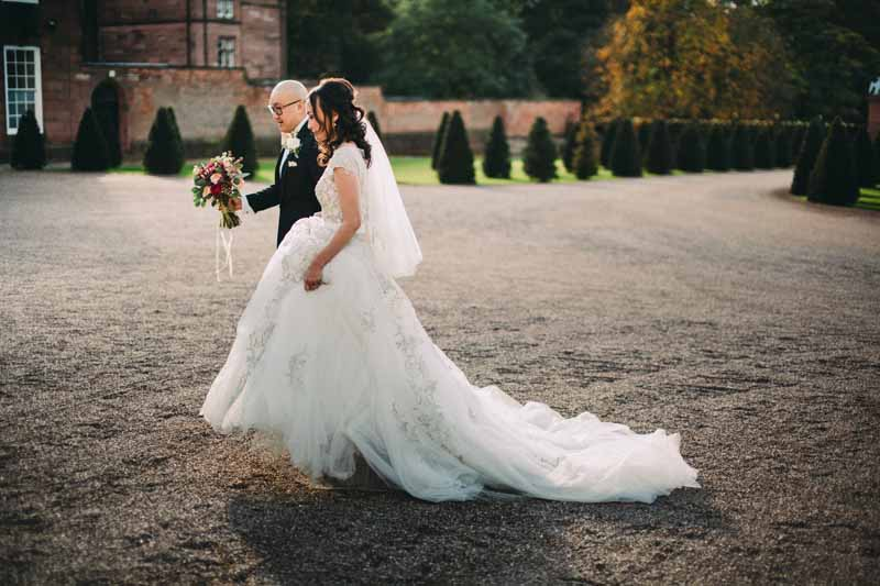 bride-and-groom-portraits-knowsley-hall-deep-pink-burgundy-wedding-bouquet-3
