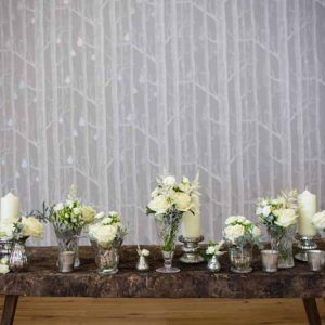 Elegant wedding ceremony table styling crystal vases mercury silver vases cream flowers