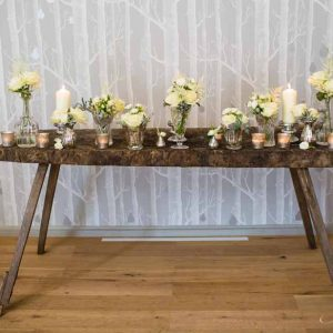Elegant wedding ceremony table styling crystal vases mercury silver vases cream flowers Hampton Manor