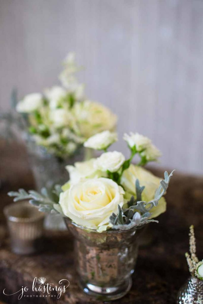 Mercury silver vases cream roses grey dusty miller