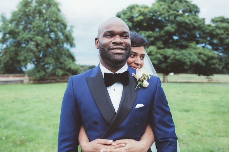 Navy blue grooms suit with black velvet bow tie