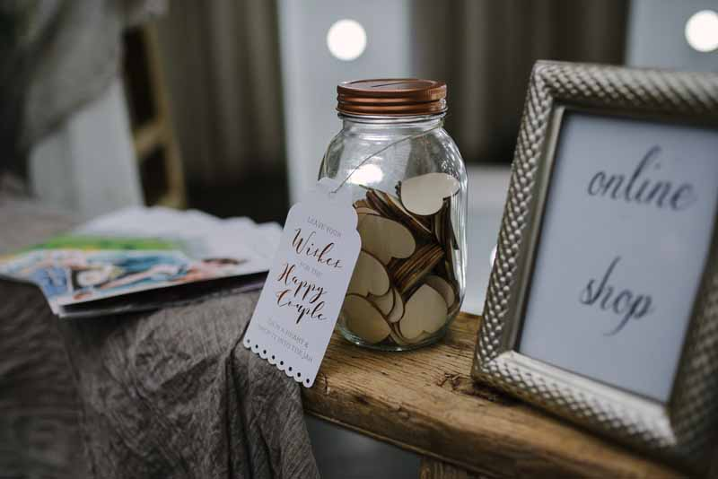Jar of hearts wedding guest book - guests write their wishes on a wooden heart and pop them in the jar