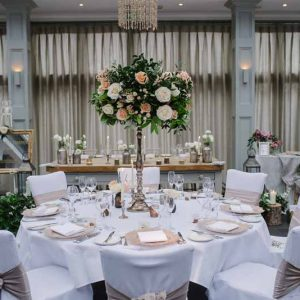 Tall bronze centrepieces wedding flowers at Hampton Manor by Passion for Flowers - peach cream foliage (2)