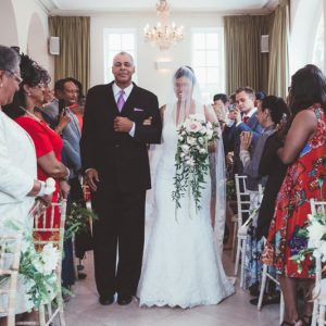 Wedding ceremony chair flowers trailing bridal bouquet Iscoy Park