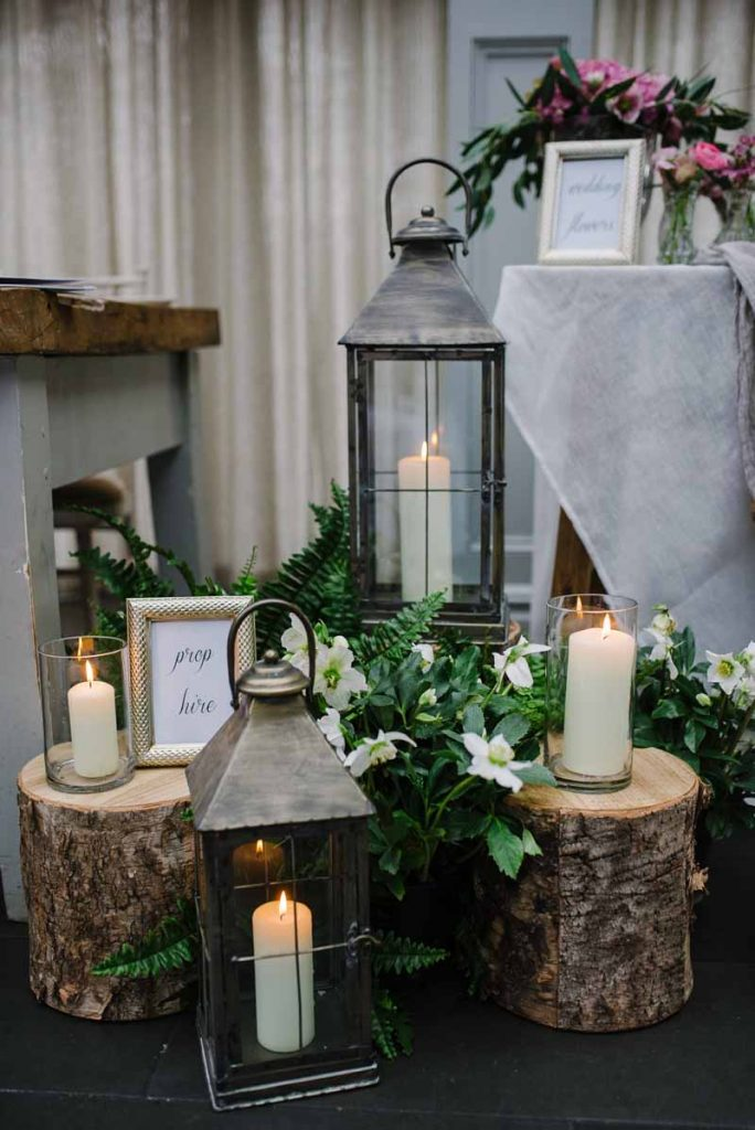Woodland wedding decorations tree stumps lanterns and ferns -Passion for Flowers (2)