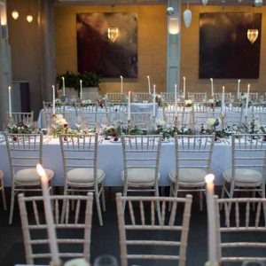 Hampton Manor wedding ceremony styling lanterns down aisle rustic trees backdrop Passion for Flowers