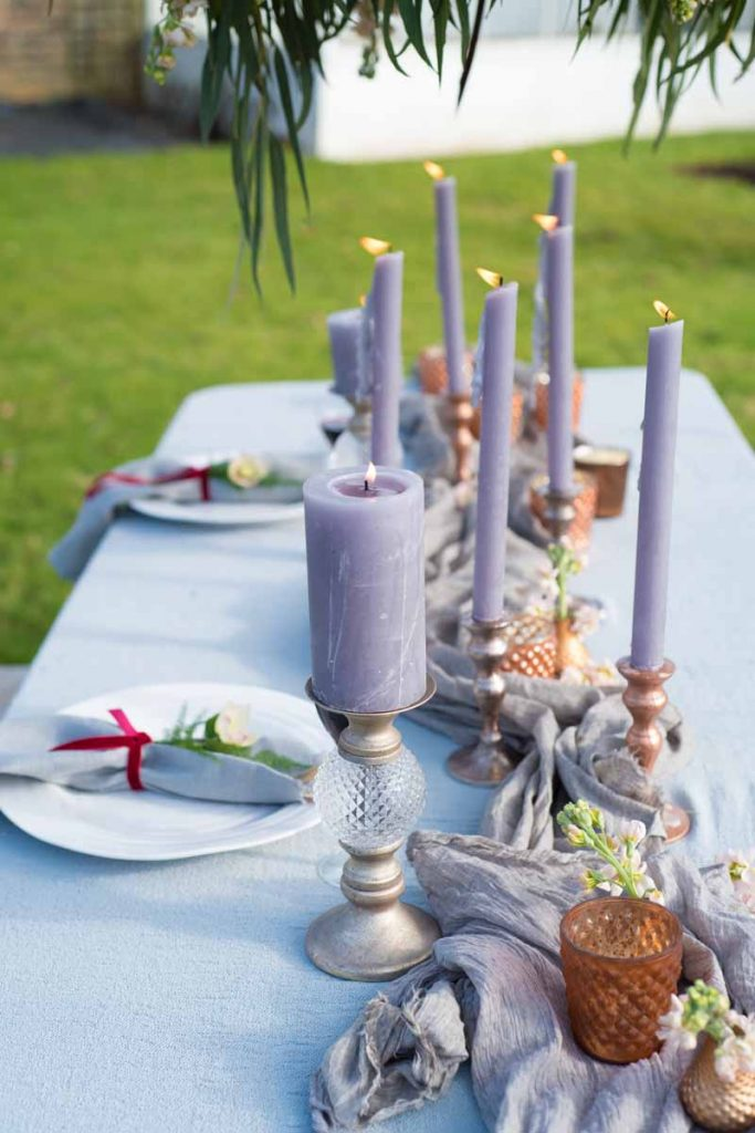 Long tables wedding candles with copper bronze gold candle sticks