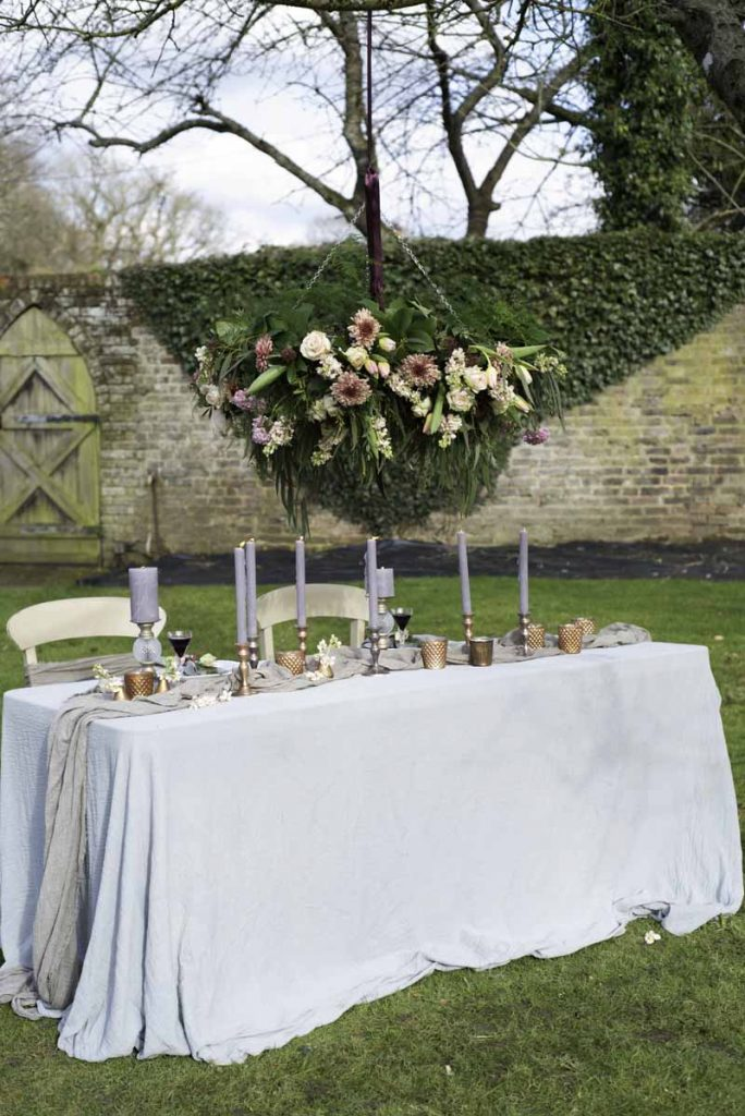 Hanging flowers over top table wedding ideas