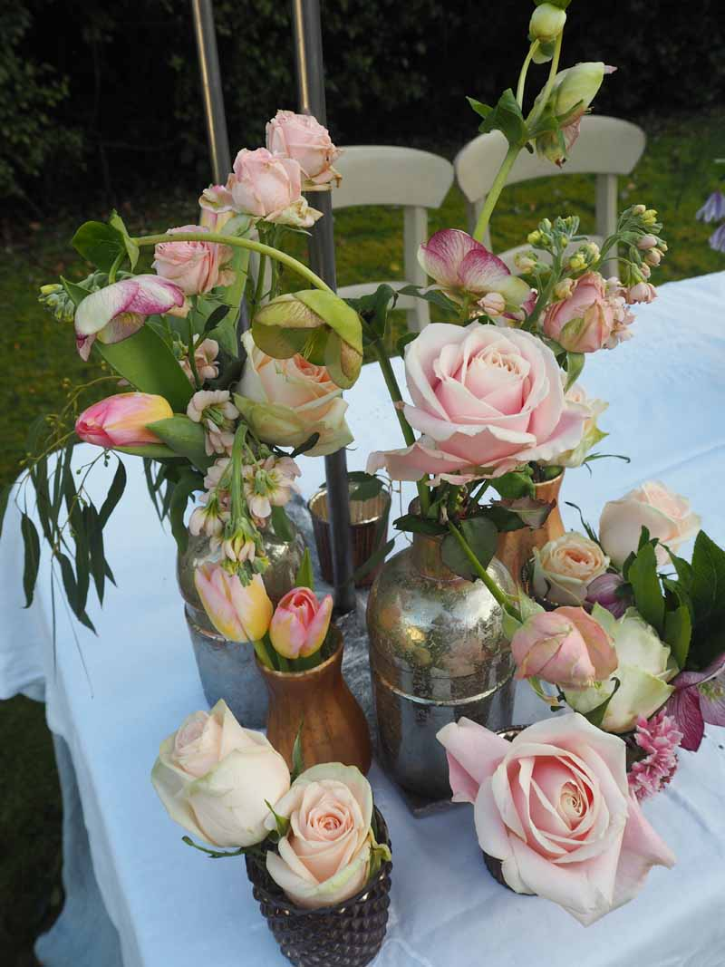Wedding Flowers grouping of bronze copper gold bottles with rose for centrepieces