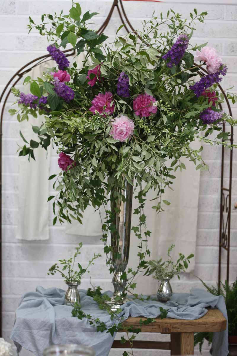 Tall Silver Vase Wedding Centrepieces with natural flowers pink purple blue learn how to make one at Passion for Flowers 1-2-1 flower school (1)