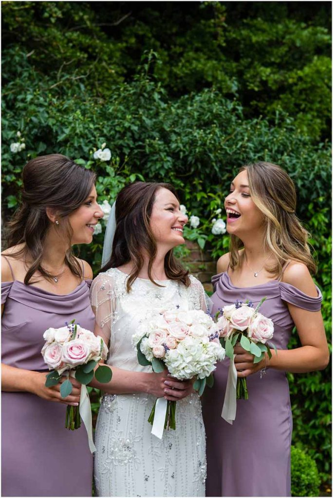 Elegant wedding flowers with lilac purple bridesmaids dresses Jenny Yoo