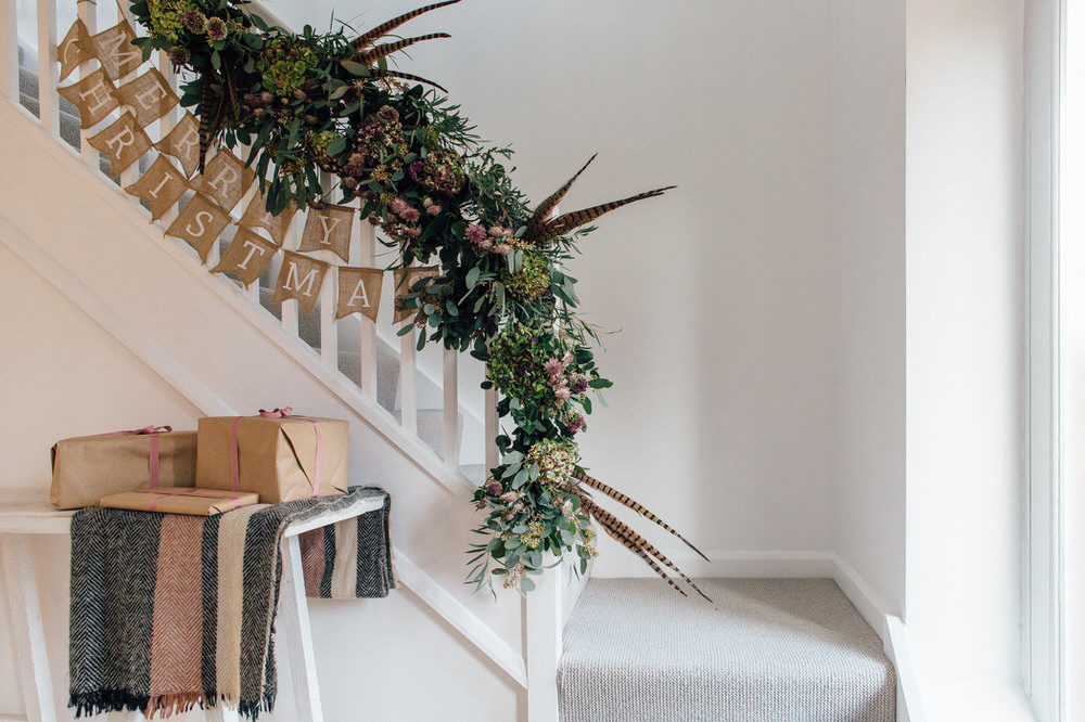 christmas staircase garland of flowers Passion for Flowers The White Company Joules