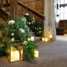 Staircase flowers foliage Hampton Manor entrance wedding florist Passion for Flowers