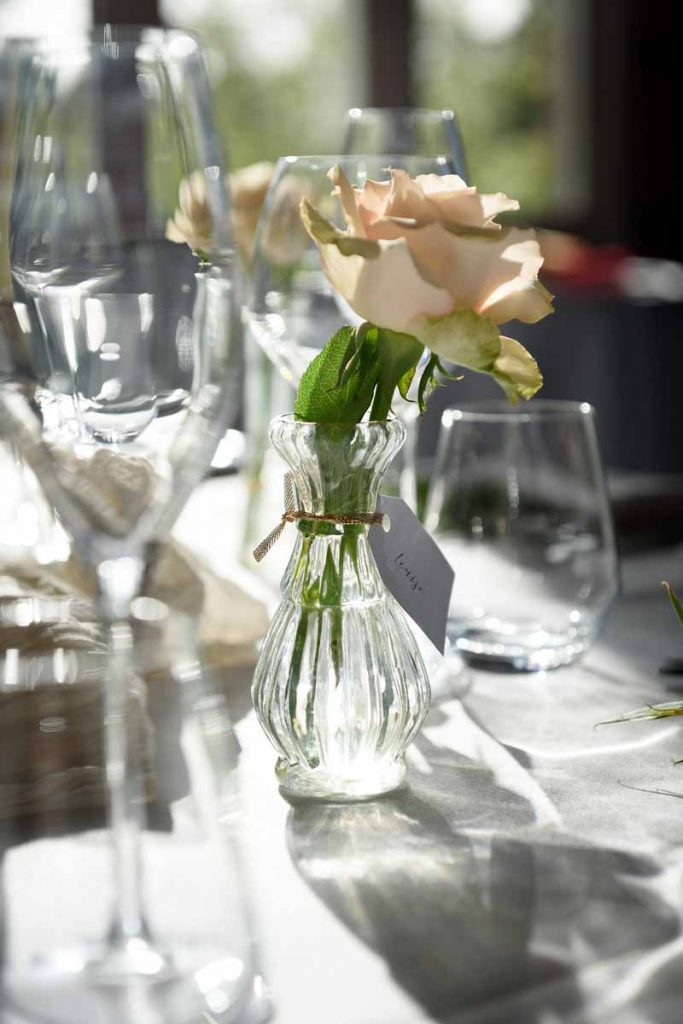 Nude roses in small posy vases autumn wedding centrepieces