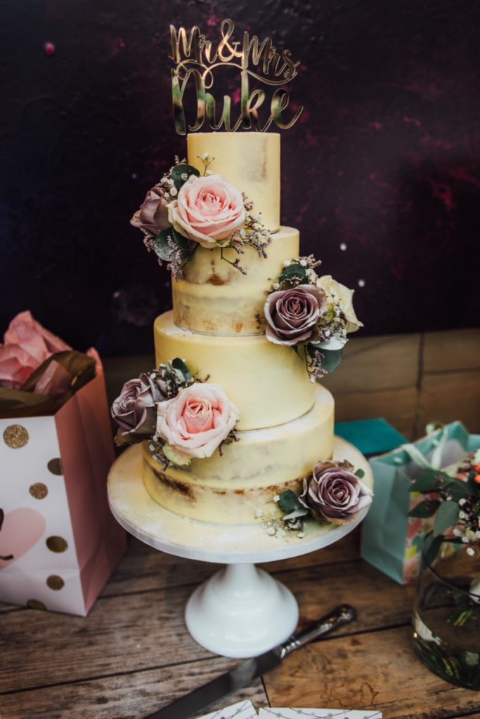 semi naked wedding cake with dusky pink roses Passion for Flowers