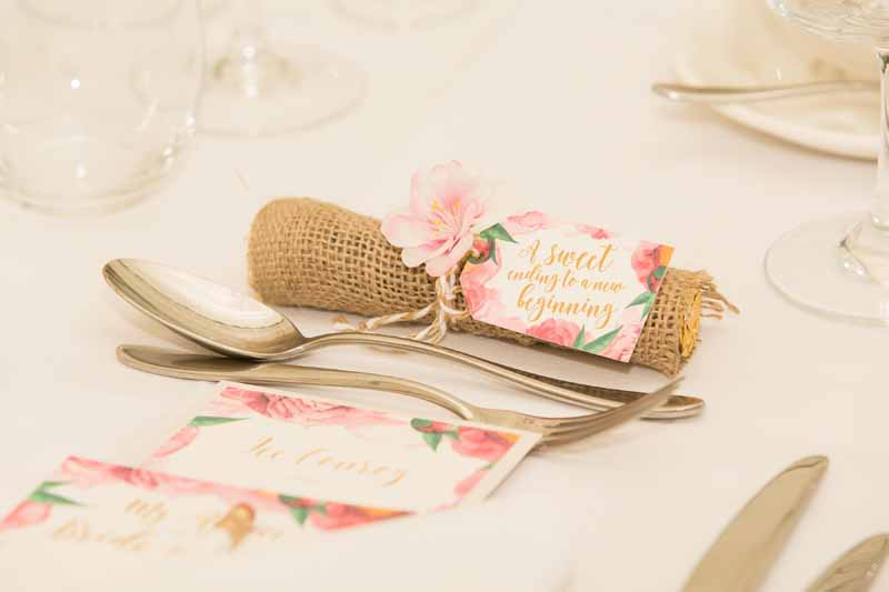 A sweet ending to a new beginning wedding favour tags tied around rolos wrapped in hessian