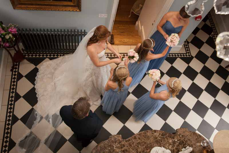 Bride and bridesmaids getting ready to walk down aisle Stanbrook Abbye