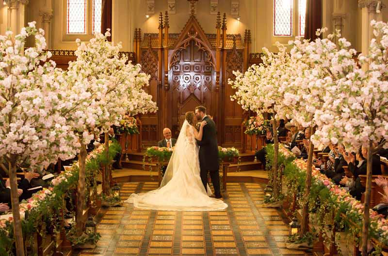 Epic wedding ceremony decorations trees metres of flowers length of the church Stanbrook Abbey wedding by Passion for Flowers 2