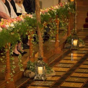 Epic wedding ceremony flowers pink peach flowers the length of the church Passion for Flowers at Stanbrook Abbey