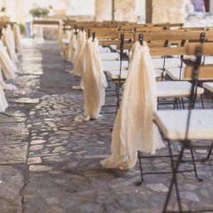 Cream material aisle decorations outdoor wedding ceremony