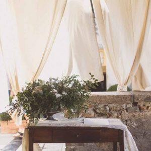organic urn of flowers wedding ceremony table Tuscany