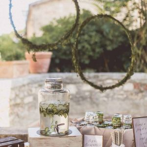 wedding reception drinks cocktail hour hanging floral hoops foliage tuscany italy