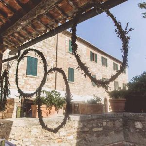 Hanging floral hoops foliage Tuscany Italy wedding