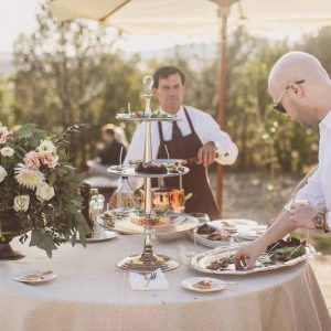 Wedding urns of flowers table food stations tuscany italy wedding