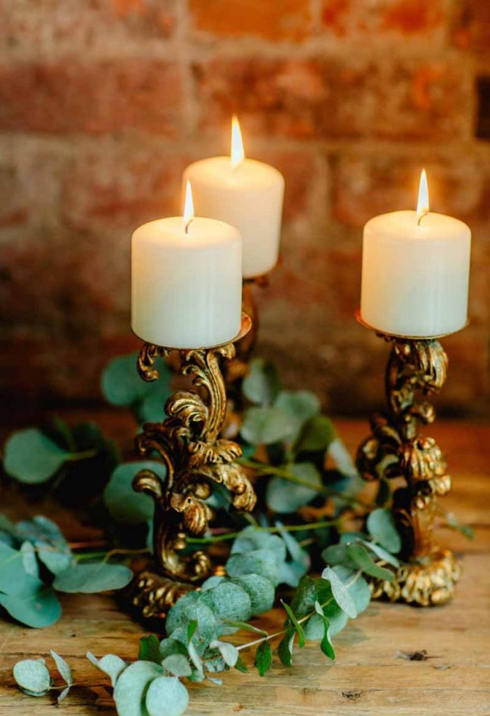 Gold ornate candle sticks for hire Passion for Flowers Shustoke Farm Barns