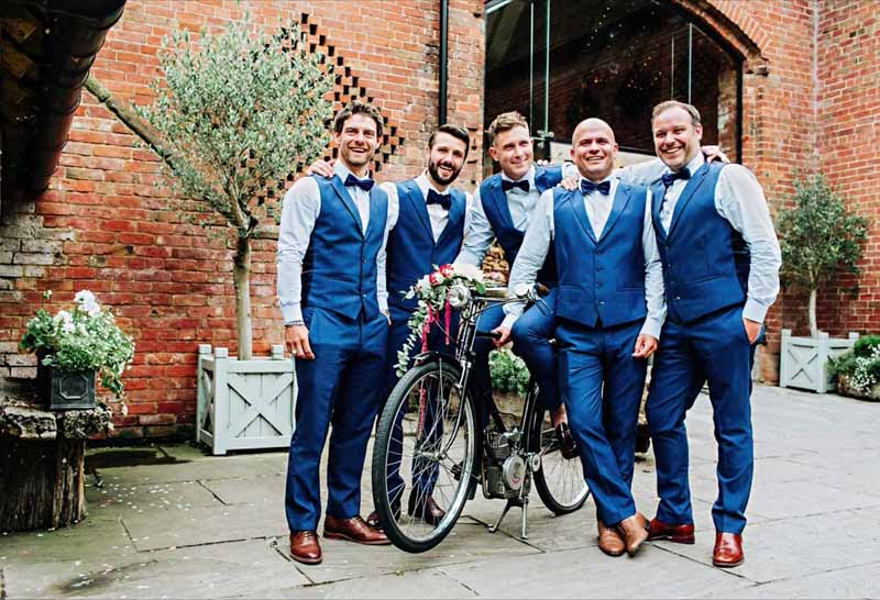 Groomsmen navy suits bicycle flowers Shustoke Farm Barns wedding florist Passion for Flowers