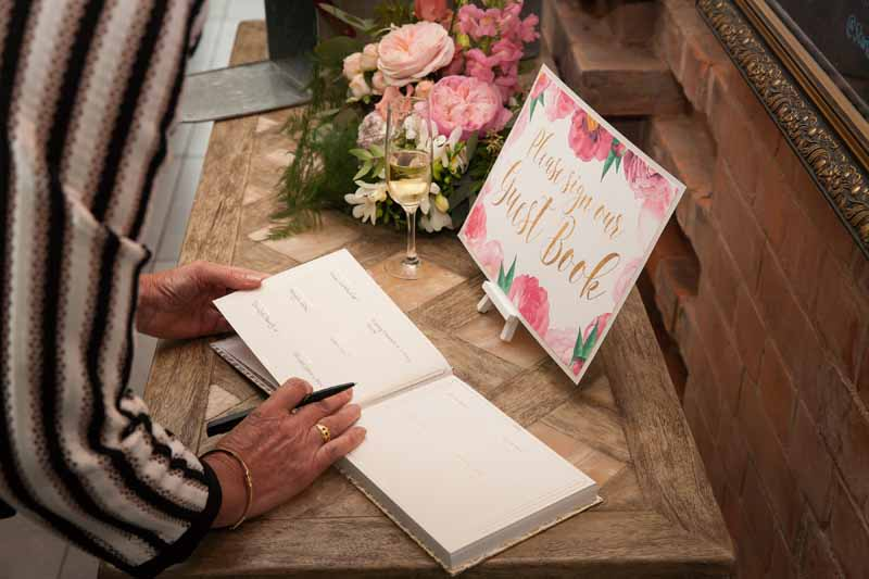 Guest book table wedding pink flowers Passion for Flowers